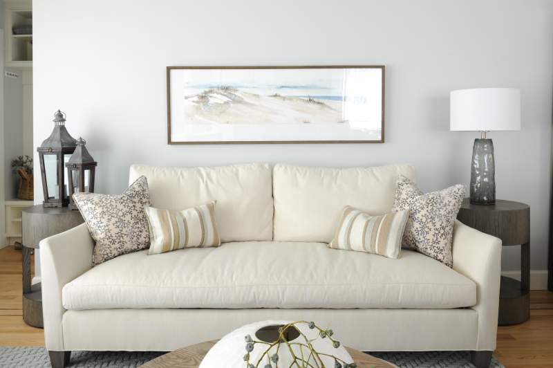natural material neutral tones living room white sofa pillows art