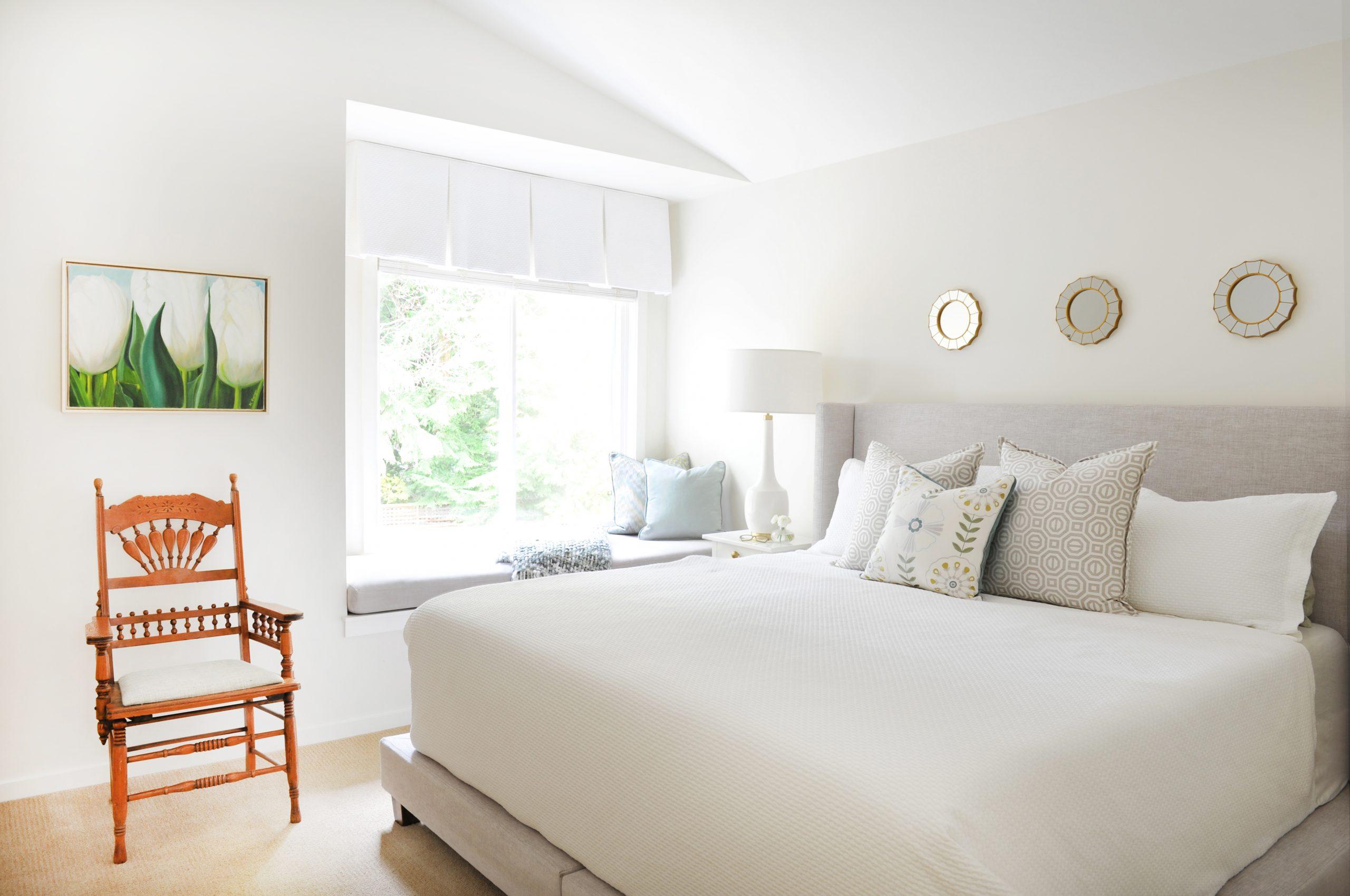 white cream bedroom wood chair green artwork interior design