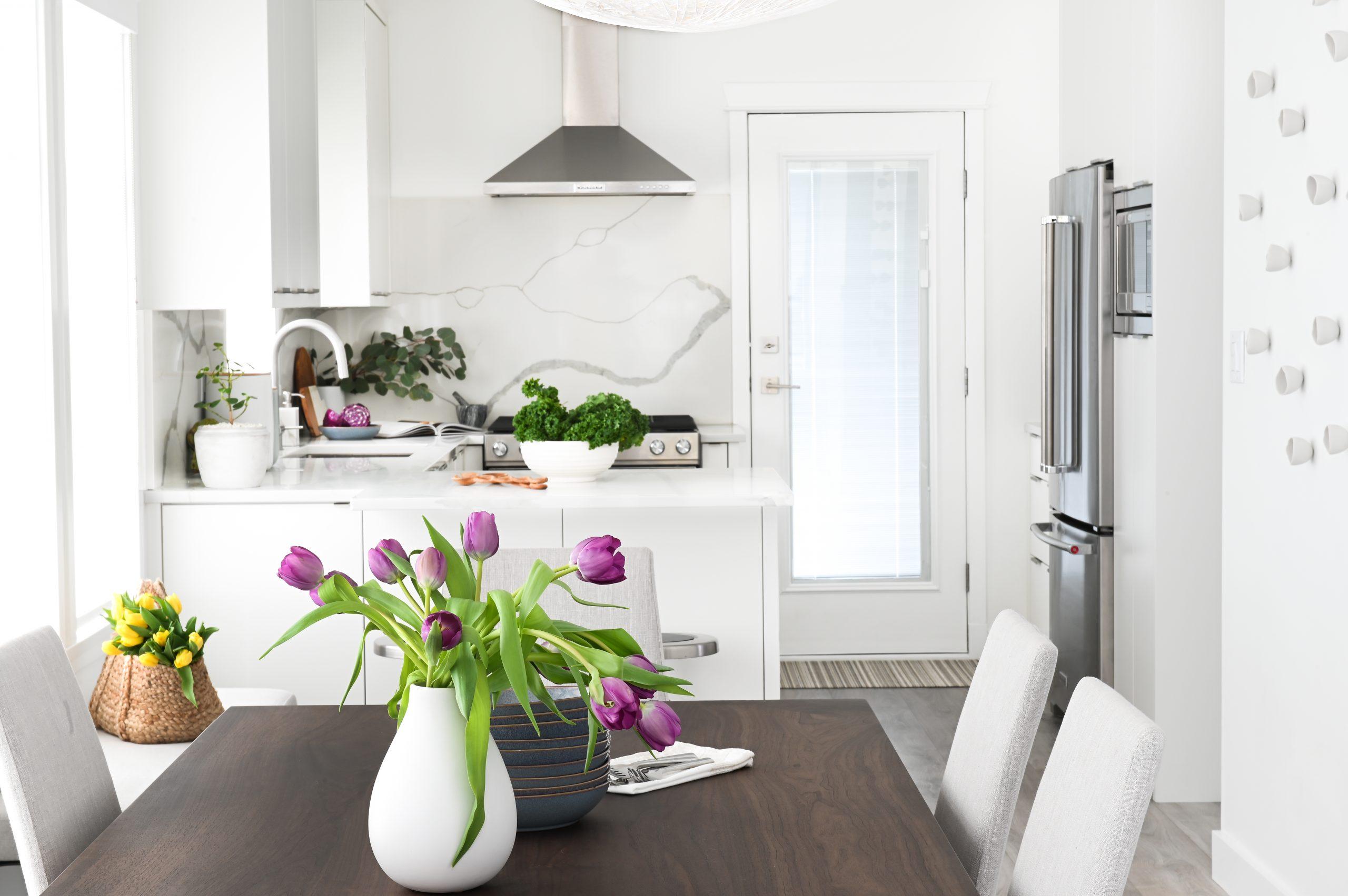 white kitchen dining table wood stone backsplash cambria quartz