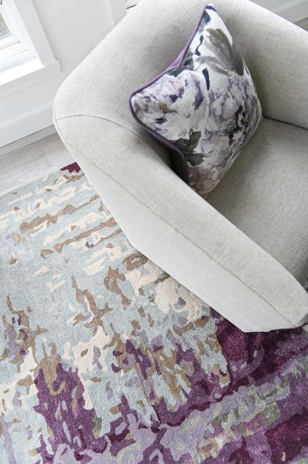 Simply-Home-Decorating_Boutique-Design-Studio_North-Vancouver-B.C._Colourful-Modern-Area-Rug_Accent-Chair_Floral-Throw-Pillow
