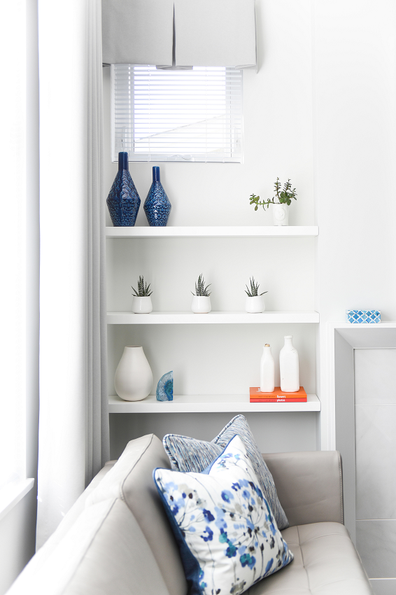 Simply-Home-Decorating_Boutique-Design-Studio_North-Vancouver-B.C._How-to-Style-Bookshelves-Like-a-Pro-in-5-Simple-Steps_Living-Room-Shelves