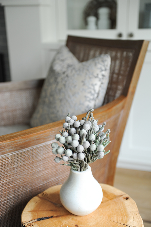 Simply-Home-Decorating_Lori-Steeves_Vancouver-BC_Canadian-Designer_How-to-Avoid-5-Huge-Home-Furnishing-Mistakes_Accent-Chair-with-Pillow-and-Wood-Side-Table-with-Flowers