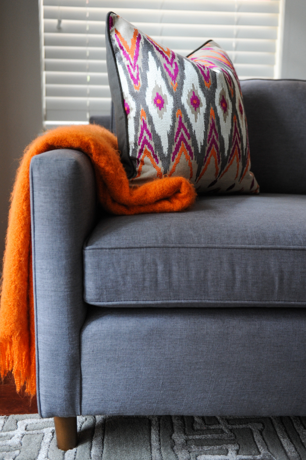 Simply-Home-Decorating_Lori-Steeves_Vancouver-BC_Canadian-Designer_How-to-Avoid-5-Huge-Home-Furnishing-Mistakes_Gray-Sofa-with-Colourful-Throw-and-Pillow