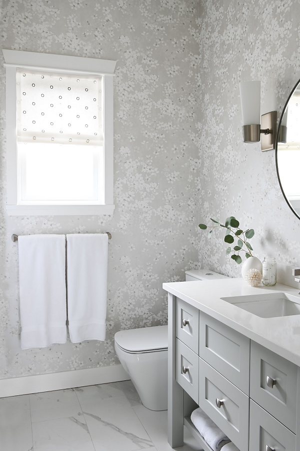 Simply-Home-Decorating_Lori-Steeves_Vancouver-BC_Canadian-Designer_A-Modern-and-Luxurious-Master-Suite-Makeover-in-Vancouver_Feminine-Bathroom-with-Floral-Wallpaper-and-Circular-Mirror