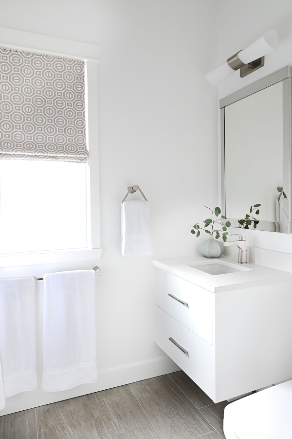 Simply-Home-Decorating_Lori-Steeves_Vancouver-BC_Canadian-Designer_A-Modern-and-Luxurious-Master-Suite-Makeover-in-Vancouver_Simple-White-Bathroom-with-Clean-Lines