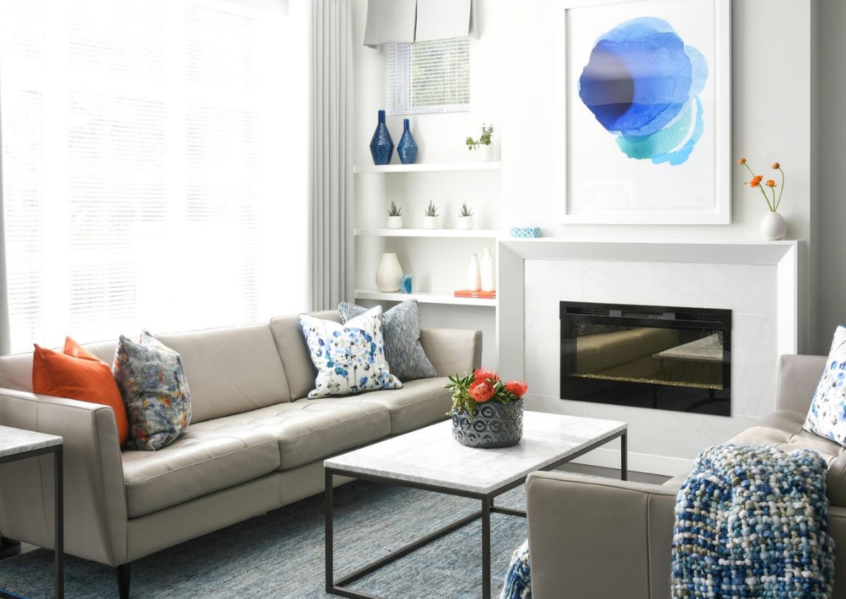 simply-home-decorating-blue-ridge-statement-pieces-interior-design-water-color-painting-above-fire-place
