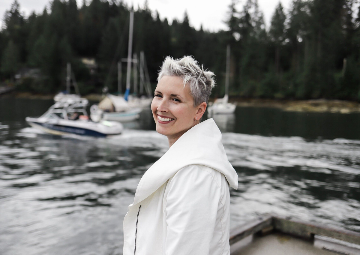 simply-home-decorating-deep-cove-ca-lessons-learned-as-a-designer-woman-standing-on-a-dock-in-white-coat