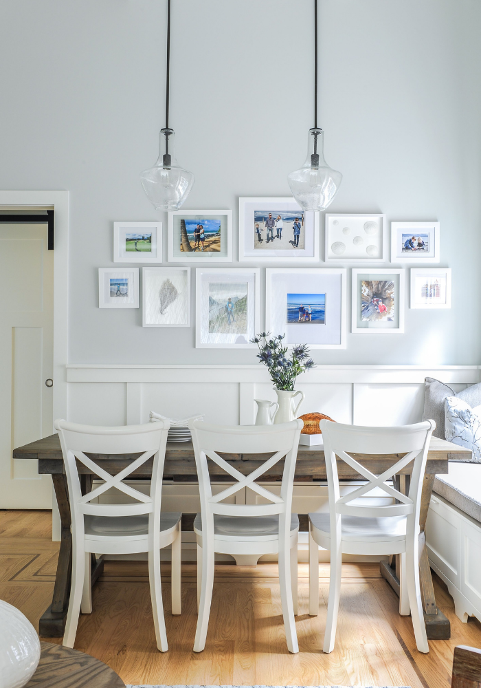 simply-home-decorating-deep-cove-statement-pieces-interior-design-dining-room-with-photo-collage-with-white-frames