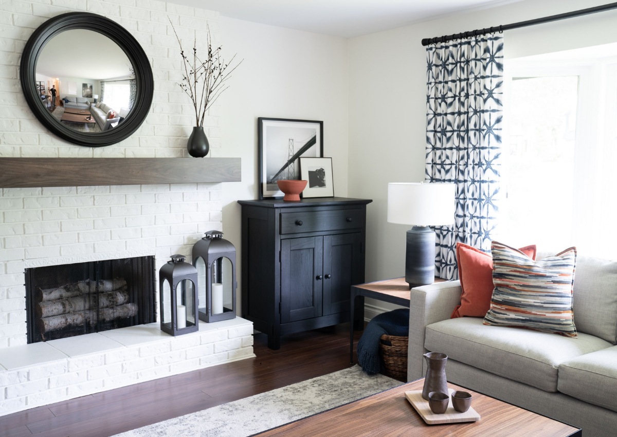 simply-home-decorating-north-vancouver-ca-lessons-learned-as-a-designer-living-room-built-in-fire-place-with-circle-mirror