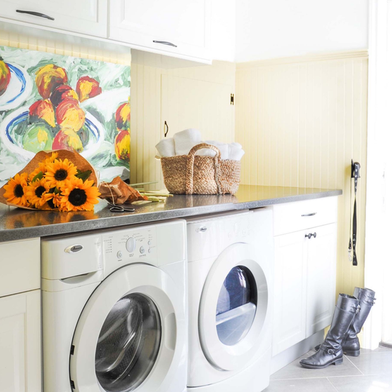 decluttering laundry room fresh bright sunny light ywllow white cabinets colourful art